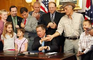 Jack Hanna with Kasich signing SB310 as law